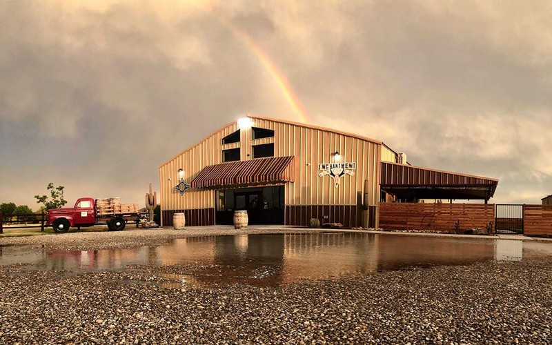 The Enchantment Vineyards tasting room underneath a rainbow. Photo by Theta Perez